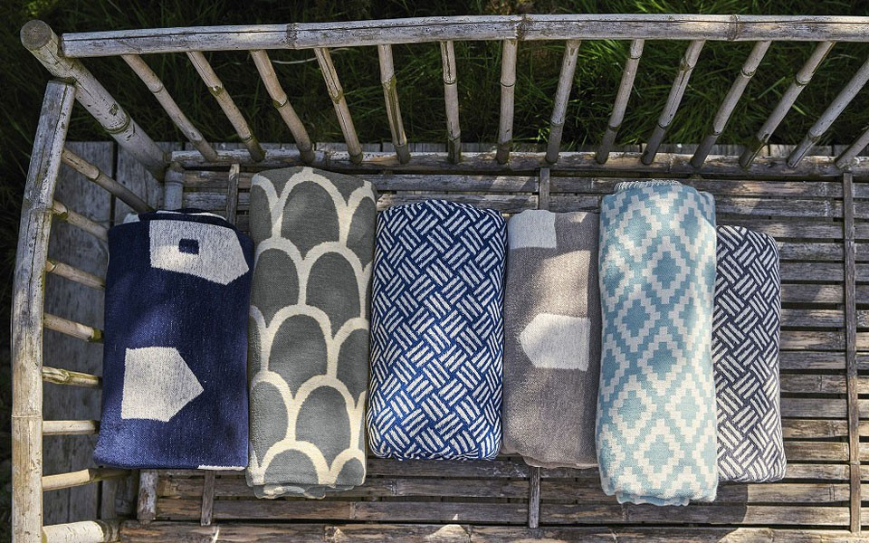 Cotton blankets on a benchグレー